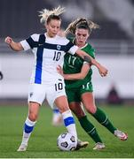 26 October 2021; Emmi Alanen of Finland in action against Jamie Finn of Republic of Ireland during the FIFA Women's World Cup 2023 qualifying group A match between Finland and Republic of Ireland at Helsinki Olympic Stadium in Helsinki, Finland. Photo by Stephen McCarthy/Sportsfile
