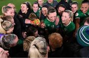 26 October 2021; Republic of Ireland players, including captain Katie McCabe, centre, and Denise O'Sullivan, right, celebrate their victory in the FIFA Women's World Cup 2023 qualifying group A match between Finland and Republic of Ireland at Helsinki Olympic Stadium in Helsinki, Finland. Photo by Stephen McCarthy/Sportsfile