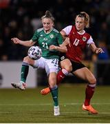 26 October 2021; Kerry Beattie of Northern Ireland in action against Virginia Kirchberger of Austria during the FIFA Women's World Cup 2023 qualifying group D match between Northern Ireland and Austria at Seaview in Belfast. Photo by Ramsey Cardy/Sportsfile