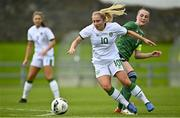 26 October 2021; Ellen Molloy of Republic of Ireland in action against Fionnuala Morgan of Northern Ireland during the UEFA Women's U19 Championship Qualifier Group 5 Qualifying Round 1 League A match between Northern Ireland and Republic of Ireland at Jackman Park in Markets Field, Limerick. Photo by Eóin Noonan/Sportsfile