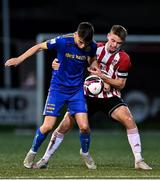 27 August 2021; Darragh Murtagh of Bohemians in action against Dean Corrigan of Derry City during the EA Sports U19 Enda McGuill Cup Final match between Derry City and Bohemians at the Ryan McBride Brandywell Stadium in Derry. Photo by Piaras Ó Mídheach/Sportsfile