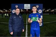 27 August 2021; Republic of Ireland Under-19 head coach Tom Mohan presents the man of the match award to Sean Grehan of Bohemians after the EA Sports U19 Enda McGuill Cup Final match between Derry City and Bohemians at the Ryan McBride Brandywell Stadium in Derry. Photo by Piaras Ó Mídheach/Sportsfile