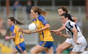 27 July 2013; Eimear Considine, Clare, in action against Louise Keatley and Paula Leatley, right, Kildare. TG4 All-Ireland Ladies Senior Football Championship, Round 1, Qualifier, Clare v Kildare, Pairc Sean Mac Diarmada, Carrick-on-Shannon, Co. Leitrim. Picture credit: Oliver McVeigh / SPORTSFILE