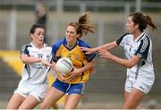 27 July 2013; Eimear Considine, Clare, in action against Paula Keatley, left, and Louise Keatley, Kildare. TG4 All-Ireland Ladies Senior Football Championship, Round 1, Qualifier, Clare v Kildare, Pairc Sean Mac Diarmada, Carrick-on-Shannon, Co. Leitrim. Picture credit: Oliver McVeigh / SPORTSFILE