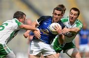 27 July 2013; Eugene Keating, Cavan, in action against Shane Mulligan, left, and Stephen Curran, London. GAA Football All-Ireland Senior Championship, Round 4, London v Cavan, Croke Park, Dublin. Picture credit: David Maher / SPORTSFILE