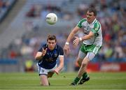 27 July 2013; Tomas Corr, Cavan, in action against Shane Mulligan, London. GAA Football All-Ireland Senior Championship, Round 4, London v Cavan, Croke Park, Dublin. Picture credit: Stephen McCarthy / SPORTSFILE