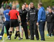 27 July 2013; Donegal manager Jim McGuinness and Laois manager Justin McNulty exchange words during a first half incident on the line. GAA Football All-Ireland Senior Championship, Round 4, Donegal v Laois, Pairc Sean Mac Diarmada, Carrick-on-Shannon, Co. Leitrim. Picture credit: Oliver McVeigh / SPORTSFILE