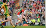 4 August 2013; Cillian O'Connor kicks the ball into an empty to score Mayo's third, and his second, goal. GAA Football All-Ireland Senior Championship, Quarter-Final, Mayo v Donegal, Croke Park, Dublin. Picture credit: Ray McManus / SPORTSFILE