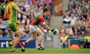 4 August 2013; Cillian O'Connor prepares to kick the ball into an empty net to score Mayo's third, and his second, goal. GAA Football All-Ireland Senior Championship, Quarter-Final, Mayo v Donegal, Croke Park, Dublin. Picture credit: Ray McManus / SPORTSFILE