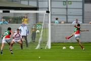 5 August 2013; Cian Hanley, Mayo, beats Westmeath goalkeeper Joe Hyland, from the penalty spot, to score his side's first goal. Electric Ireland GAA Football All-Ireland Minor Championship Quarter-Final, Mayo v Westmeath, O'Connor Park, Tullamore, Co. Offaly. Picture credit: David Maher / SPORTSFILE