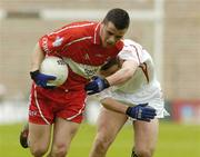 9 May 2004; Brendan Mullin, Derry, in action against Paul Marlowe, Tyrone. Ulster Minor Football Championship, Tyrone v Derry, St. Tighernach's Park, Clones, Co. Monaghan. Picture credit; Pat Murphy / SPORTSFILE