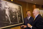 3 June 2004; Former Great Britain athlete Roger Bannister, right, who was the first athlete to break the four minute mile, admires a framed charcoal drawing of the famous moment with former Irish athlete Eamonn Coghlan, at the Westbury Hotel, Dublin. Picture credit; Brian Lawless / SPORTSFILE
