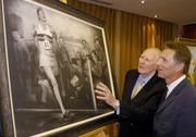 3 June 2004; Former Great Britain athlete Roger Bannister, who was the first athlete to break the four minute mile, admires a framed charcoal drawing of the famous moment with former Irish athlete Eamonn Coghlan, at the Westbury Hotel, Dublin. Picture credit; Brian Lawless / SPORTSFILE