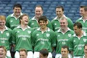 3 June 2004; Ireland second row Donnacha O'Callaghan, centre, gives his team-mates something to laugh about by wearing some false ears and teeth during the Irish rugby squad photo before their departure to South Africa. Included in the photo are, back row, from left, Reggie Corrigan, Frank Sheahan, Marcus Horan and Tyrone Howe, centre, from left, Paul O'Connell, Malcolm O'Kelly, Donnacha O'Callaghan, Victor Costello, and Guy Easterby and front, Brian O'Driscoll, Eddie O'Sullivan, Ronan O'Gara, Kevin Maggs and Girvan Dempsey. Picture credit; Brendan Moran / SPORTSFILE