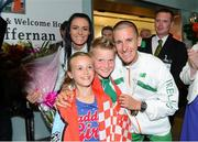 16 August 2013; Men's 50k walk gold medal winner Robert Heffernan with his wife Marian and children Cathal, age 8, and Meghan, age 10, in Dublin airport on his return from the IAAF World Athletics Championships in Moscow. Dublin Airport, Dublin. Picture credit: Paul Mohan / SPORTSFILE