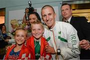 16 August 2013; Men's 50k walk gold medal winner Robert Heffernan with his wife Marian and children Cathal, age 8, and Meghan, age 10, and his agent Derry McVeigh, in Dublin airport on his return from the IAAF World Athletics Championships in Moscow. Dublin Airport, Dublin. Picture credit: Brian Lawless / SPORTSFILE