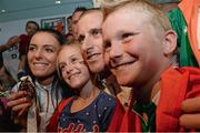 16 August 2013; Men's 50k walk gold medal winner Robert Heffernan with his wife Marian and children Cathal, age 8, and Meghan, age 10, in Dublin airport on his return from the IAAF World Athletics Championships in Moscow. Dublin Airport, Dublin. Picture credit: Brian Lawless / SPORTSFILE