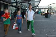 16 August 2013; Men's 50k walk gold medal winner Robert Heffernan with children Cathal, age 8, and Meghan, age 10, in Dublin airport on his return from the IAAF World Athletics Championships in Moscow. Dublin Airport, Dublin. Picture credit: Brian Lawless / SPORTSFILE