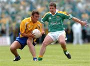 20 June 2004; Brian Higgins, Roscommon, in action against Niall Gibane, Leitrim. Bank of Ireland Connacht Senior Football Championship Semi-Final, Leitrim v Roscommon, O'Moore Park, Carrick-on-Shannon, Co. Leitrim. Picture credit; David Maher / SPORTSFILE