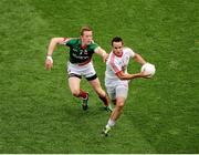 25 August 2013; Mark Donnelly, Tyrone, in action against Donal Vaughan, Mayo. GAA Football All-Ireland Senior Championship Semi-Final, Mayo v Tyrone, Croke Park, Dublin. Picture credit: Dáire Brennan / SPORTSFILE