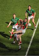 25 August 2013; Conor Clarke, Tyrone, in action against Mayo players, from left, Donal Vaughan, Keith Higgins and Alan Dillon. GAA Football All-Ireland Senior Championship Semi-Final, Mayo v Tyrone, Croke Park, Dublin. Picture credit: Dáire Brennan / SPORTSFILE