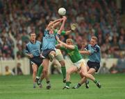 21 August 1994; Dublin's Brian Stynes contests a high ball with Leitrim's Pat Donohue as Leitrim's George Dugdale and Dublin's Keith Barr with Paul Clarke, left, await the breaking ball. Bank of Ireland Football Championship Semi Final. Dublin v Leitrim. Croke Park. Dublin. Picture credit; Ray McManus / SPORTSFILE