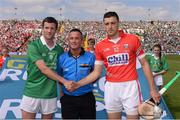 14 July 2013; Limerick captain Donal O'Grady and Cork captain Pa Cronin shake hands in front of referee James McGrath. Munster GAA Hurling Senior Championship Final, Limerick v Cork, Gaelic Grounds, Limerick. Picture credit: Ray McManus / SPORTSFILE