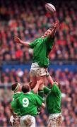 Five Nations Rugby International, England v Ireland, Twickenham, 4/4/98. Ireland's Malcolm O'Kelly wins this lineout against England with the help of Paul Wallace, left, and David Corkery as Conor McGuinness (9) awaits the dropping ball . Photograph © Matt Browne SPORTSFILE.