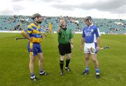 26 June 2004; Referee Michael Haverty makes the toss between Clare's Sean McMahon and David Cuddy, Laois. Guinness Senior Hurling Championship Qualifier, Round 1, Clare v Laois, Gaelic Grounds, Limerick. Picture credit; Ray McManus / SPORTSFILE