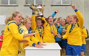 1 September 2013; Douglas Hall LFC captain Eileen Ring lifts the cup after victory over Colga FC. FAI Umbro Women's Intermediate Cup Final, Colga FC v Douglas Hall LFC, Fahy's Field, Galway. Picture credit: Diarmuid Greene / SPORTSFILE