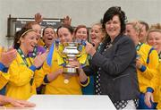 1 September 2013; Douglas Hall LFC captain Eileen Ring is presented with the cup by WFAI Tresurer Frances Smith. FAI Umbro Women's Intermediate Cup Final, Colga FC v Douglas Hall LFC, Fahy's Field, Galway. Picture credit: Diarmuid Greene / SPORTSFILE