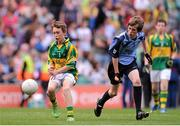 1 September 2013; Aidan Cassidy, representing Rathmore N.S. Naas, Co. Kildare, in action against Ronan Fox, representing Lisnagry N.S. Lisnagry, Co. Limerick, during the INTO/RESPECT Exhibition GoGames at the GAA Football All-Ireland Senior Championship Semi-Final between Dublin and Kerry. Croke Park, Dublin. Picture credit: Brian Lawless / SPORTSFILE