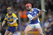 26 June 2004; Michael McEvoy, Laois, in action against Tony Griffin, Clare. Guinness Senior Hurling Championship Qualifier, Round 1, Clare v Laois, Gaelic Grounds, Limerick. Picture credit; Ray McManus / SPORTSFILE