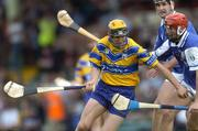 26 June 2004; Tony Griffin, Clare, in action against Michael McEvoy, and Paul Cuddy, back, Laois. Guinness Senior Hurling Championship Qualifier, Round 1, Clare v Laois, Gaelic Grounds, Limerick. Picture credit; Ray McManus / SPORTSFILE