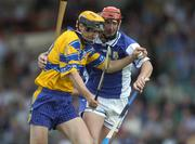 26 June 2004; Tony Griffin, Clare, in action against Michael McEvoy, Laois. Guinness Senior Hurling Championship Qualifier, Round 1, Clare v Laois, Gaelic Grounds, Limerick. Picture credit; Ray McManus / SPORTSFILE