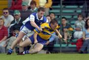 26 June 2004; Barry Murphy, Clare, in action against Cyril Cuddy, Laois. Guinness Senior Hurling Championship Qualifier, Round 1, Clare v Laois, Gaelic Grounds, Limerick. Picture credit; Ray McManus / SPORTSFILE