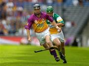4 July 2004; Wexford's Tomas Mahon looses his hurl on his way past Barry Teehan, Offaly. Guinness Leinster Senior Hurling Championship Final, Offaly v Wexford, Croke Park, Dublin. Picture credit; Pat Murphy / SPORTSFILE