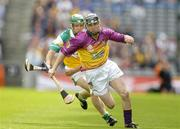 4 July 2004; Wexford's Tomas Mahon in action against Barry Teehan, Offaly. Guinness Leinster Senior Hurling Championship Final, Offaly v Wexford, Croke Park, Dublin. Picture credit; Pat Murphy / SPORTSFILE