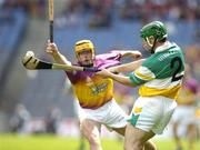4 July 2004; Barry Teehan, Offaly, clears under pressure from Wexford's Eoin Quigley. Guinness Leinster Senior Hurling Championship Final, Offaly v Wexford, Croke Park, Dublin. Picture credit; Pat Murphy / SPORTSFILE