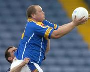 10 July 2004; Niall Sheridan, Longford, is tackled by Paddy Christie, Dublin. Bank of Ireland Senior Football Championship Qualifier, Round 3, Dublin v Longford, O'Moore Park, Portlaoise, Co. Laois. Picture credit; Pat Murphy / SPORTSFILE