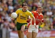 11 July 2004; Michael Hegarty, Donegal, is tackled by Diarmuid Marsden, Armagh. Bank of Ireland Ulster Senior Football Championship Final, Armagh v Donegal, Croke Park, Dublin. Picture credit; Matt Browne / SPORTSFILE
