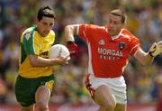 11 July 2004; Michael Hegarty, Donegal, is tackled by Diarmuid Marsden, Armagh. Bank of Ireland Ulster Senior Football Championship Final, Armagh v Donegal, Croke Park, Dublin. Picture credit; Matt Browne / SPORTSFILEE