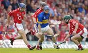 10 July 2004; Eoin Kelly, Tipperary, in action against Brian Murphy, left, Wayne Sherlock and Jerry O'Connor, Cork. Guinness Senior Hurling Championship Qualifier, Round 3, Cork v Tipperary, Fitzgerald Stadium, Killarney, Co. Kerry. Picture credit; Brendan Moran / SPORTSFILE