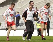 17 July 2004; Tyrone manager Mickey Harte speaks to his players, from left, Michael Coleman, Ryan McMenamin and Shane Sweeney during the warm down. Bank of Ireland Senior Football Championship Qualifier, Round 3, Tyrone v Galway, Croke Park, Dublin. Picture credit; Damien Eagers / SPORTSFILE