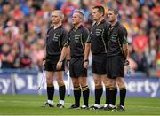 8 September 2013; Referee Brian Gavin, second from right, stands with his officials, from left, Johnny Ryan, James McGrath and James Owen stand for a minute silence ahead of the game. GAA Hurling All-Ireland Senior Championship Final, Cork v Clare, Croke Park, Dublin. Picture credit: Stephen McCarthy / SPORTSFILE
