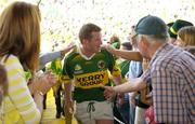 18 July 2004; Kerry captain Dara O'Cinneide is congratulated by fans as he makes his way to collect the cup. Bank of Ireland Munster Senior Football Championship Final Replay, Kerry v Limerick, Fitzgerald Stadium, Killarney, Co. Kerry. Picture credit; Brendan Moran / SPORTSFILE