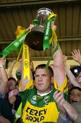 18 July 2004; Kerry captain Dara O'Cinneide lifts the Munster cup after victory over Limerick. Bank of Ireland Munster Senior Football Championship Final Replay, Kerry v Limerick, Fitzgerald Stadium, Killarney, Co. Kerry. Picture credit; Brendan Moran / SPORTSFILE