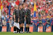 8 September 2013; Referee Brian gavin, 3rd from left, and his match officials Johnny Ryan, James McGrath and James Owens, stand for a minute's silence before the game. GAA Hurling All-Ireland Senior Championship Final, Cork v Clare, Croke Park, Dublin. Picture credit: Brendan Moran / SPORTSFILE