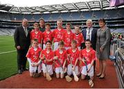 8 September 2013; Uachtarán Chumann Lúthchleas Gael Liam Ó Néill, left, INTO President Breandán Ó Suilleabháin, President of the Camogie Association Aileen Lawlor, with the Cork team, back row, left to right, Shane O'Boyle, Luke O'Connor, Liam Delaney, Kieran O'Sullivan, Conall Byrne, front row, left to right, Eoin Flaherty, Owen McDermott, Cathal Feeney, Paddy McDermott, Jack Murphy. INTO/RESPECT Exhibition GoGames during the GAA Hurling All-Ireland Senior Championship Final between Cork and Clare, Croke Park, Dublin. Picture credit: Dáire Brennan / SPORTSFILE