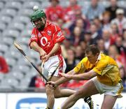 25 July 2004; Jerry O'Connor, Cork, is tackled by Antrim's Kieran Kelly. Guinness All-Ireland Senior Hurling Championship, Quarter Final, Antrim v Cork, Croke Park, Dublin. Picture credit; Brian Lawless / SPORTSFILE